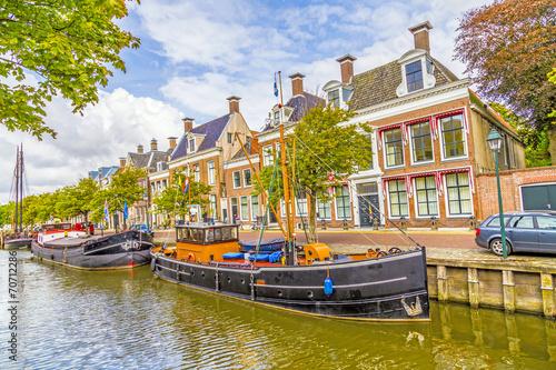 Leinwanddruck Bild boats in a canal in Harlingen