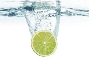 lime splashing into water