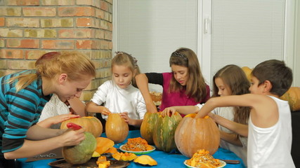 Group of Children Carving Halloween Pumpkins