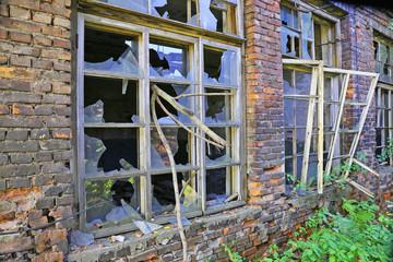 Broken windows in an old industrial building