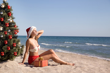 young girl sunbathes on the beach at Christmas holidays
