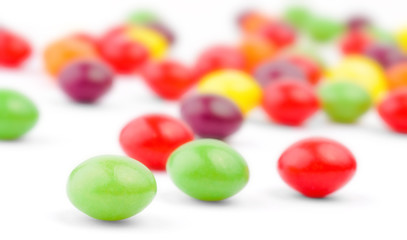 An assortment of colorful candy on white background