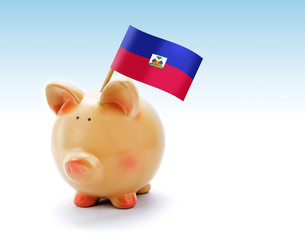 Piggy bank with national flag of Haiti