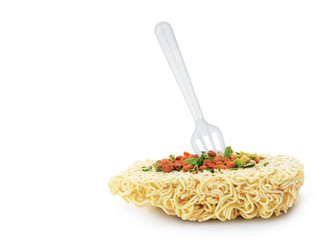 Uncooked fast food vermicelli with fork