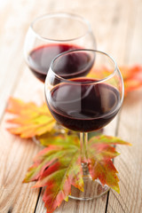 Red wine and autumn leaves.