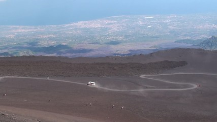 Terrain vehicles & Tourists on the way to Etna crater area Etna