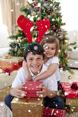Happy brother and sister celebrating christmas