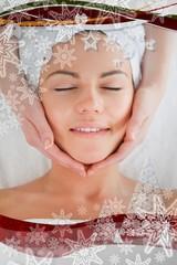 Smiling woman having a facial massage