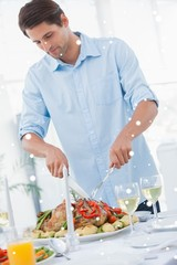Attractive man carving the dinner