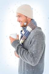 Handsome man in winter fashion holding mug