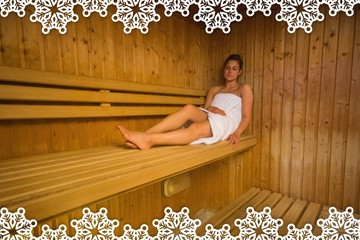 Calm brunette relaxing in a sauna