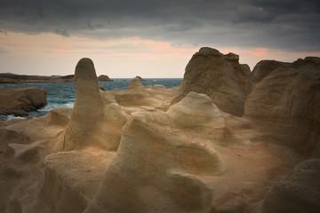 Rock formations in Milos, Greece.