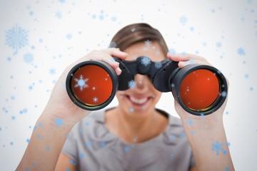 Woman looking through spyglasses