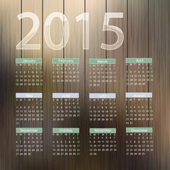 Calendar for 2015 on wood background.