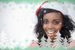 Woman wearing a santa claus hat