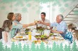 Composite image of family toasting while having meal