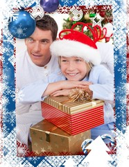 Smiling father and his son holding christmas gifts