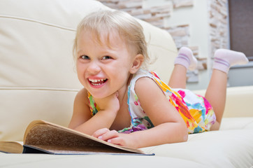 Little smiling girl with book