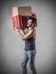 Man carrying a heavy box