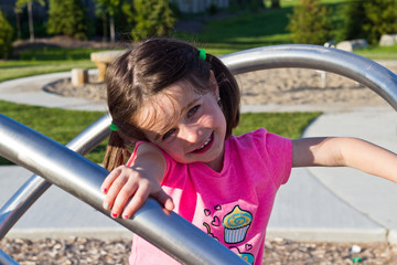 Little girl having fun at the playground