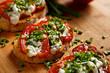 Bruschetta with  tomato,  cheese  and fresh chive