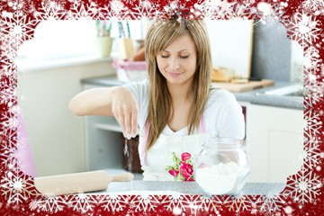 Portrait of a cute woman preparing a cake in the kitchen