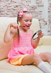 Little girl puts makeup