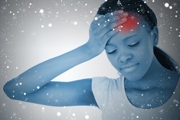 Composite image of woman with highlighted headache