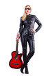 Woman in leather suit with guitar on white