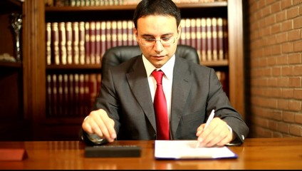 Businessman doing paperworks in his office