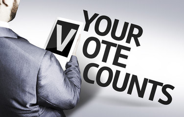 Business man with the text Your Vote Counts