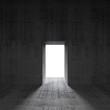 Abstract dark concrete interior with glowing door, 3d render
