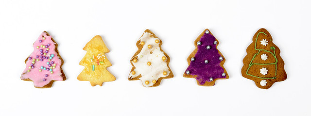 Homemade christmas gingerbread cookies on a white background