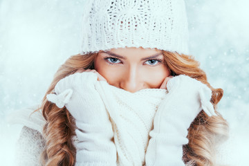 Blue eyed woman hiding her face with a scarf