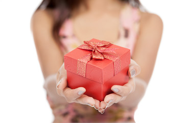 Close up of Asian woman give red gift box focus on the gift