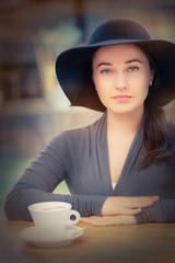 Elegant Young Woman Having Coffee