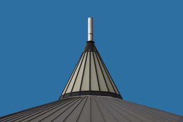 Roof top cone against a blue sky.
