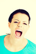 Young woman screaming with anger