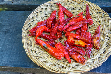 dried chili peppers on  wooden table