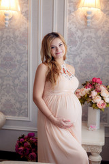 Happy pregnant woman in the room