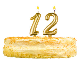 birthday cake with candles number twelve isolated on white
