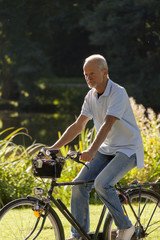 Senior Man Riding Bicycle