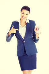 Business woman with her piggy bank.