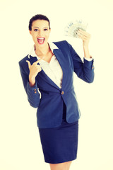 Happy attractive businesswoman holding euros