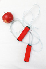 Ready for gym - jumping rope with an apple