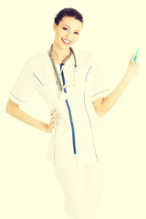 Female doctor or nurse holding syringe