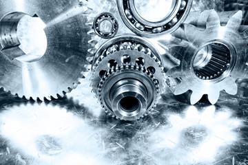 cogwheels, gears and titanium parts against aluminum