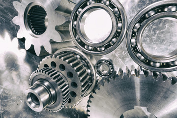 cogwheels and ball-bearings, titanium and steel