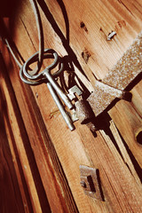 old keys and ring against anrique barn door