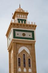 Mosque minaret against a blue sky